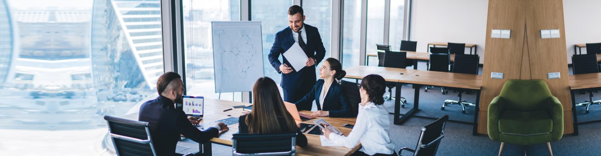 Adult entrepreneur in formal wear standing in conference room