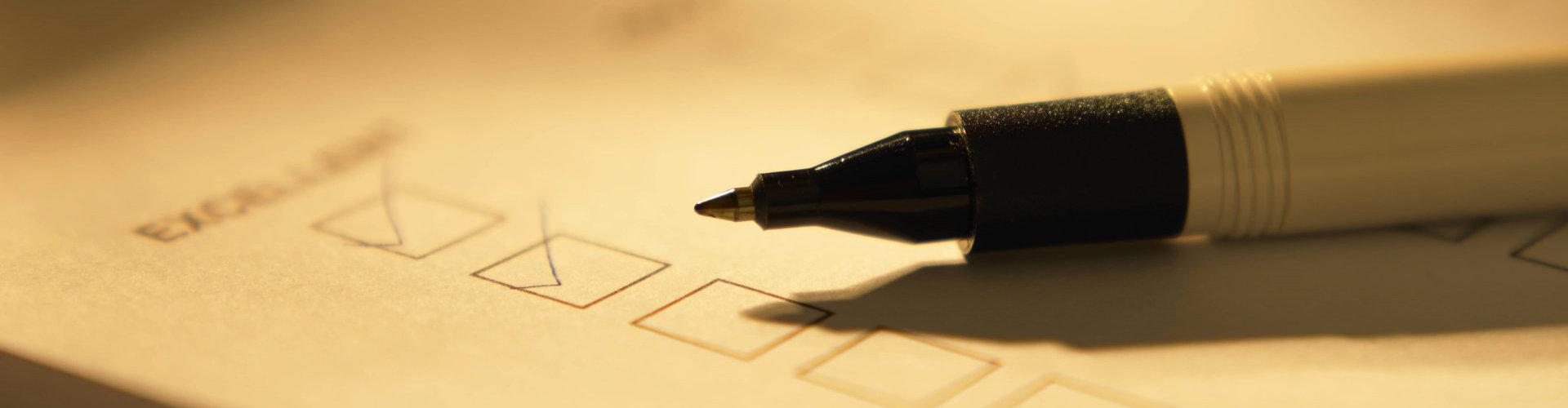 pen on top of a survey sheet