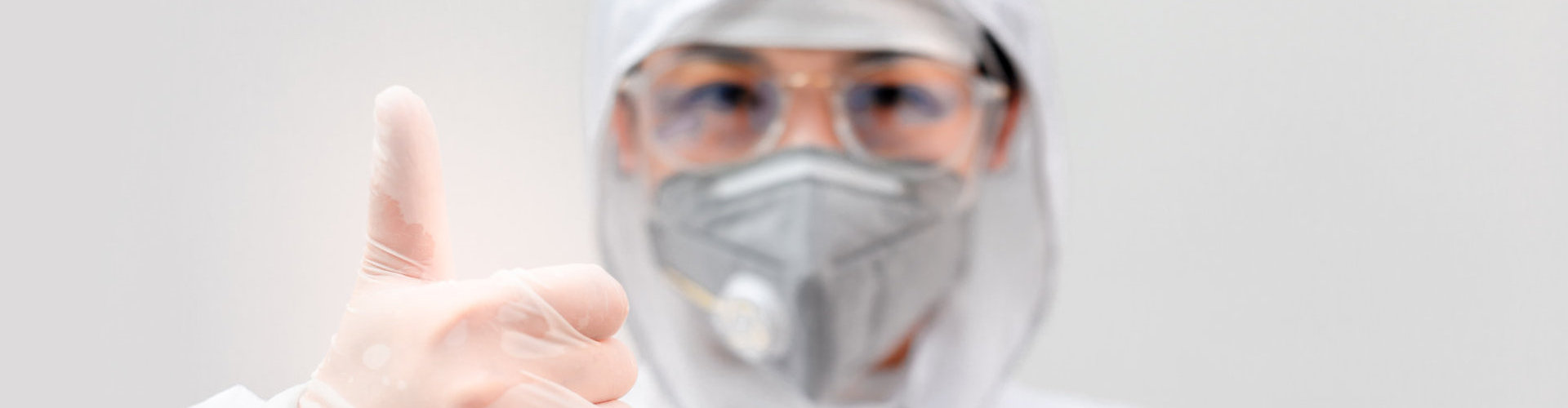 medical staff wearing PPE doing OK sign